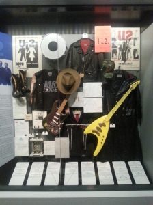 U2 -Still love this band and always will. I saw Adam use this bass on the Pop Mart tour in Prauge Czech Republic. The jacket Bono wore at the 2001 Super Bowl with the American flag inside is in here too. By the way Patriots won their first super bowl after this performance.